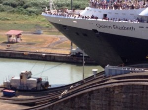 Queen Eliabeth is guided by mini trains through the Miraflores Locks of Panama Canal