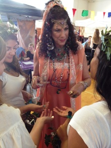 Natasha, The Psychic Lady reveals the mysteries in palms at a student Renaissance Faire