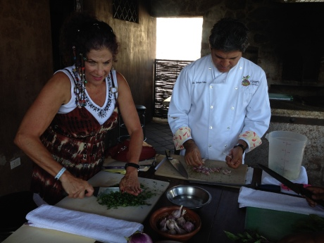 Chopping cilantro and garlic with Chef Enrique Silva at Huerta Los Tamarindos