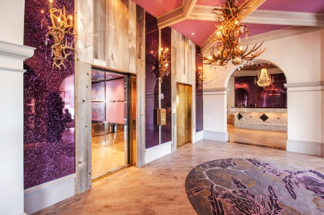 The Castle Hotel's renovated lobby exudes the elegance of an upscale hunting lodge.