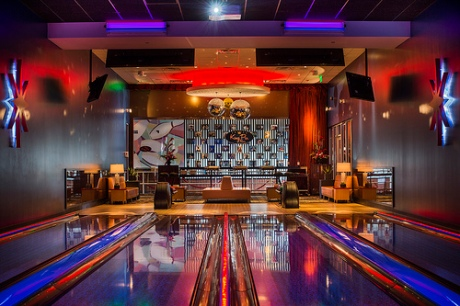 One of two private rooms at King's Bowl Orlando comes with four bowling lanes, giant hdtv projector, leather seating and dedicated buffet area
