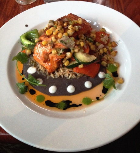 Coyotes' Pan Roasted Chimayo Chile & Honey Glazed Salmon, served with a black bean sauce and smoked corn salsa. photo by Karen Kuzsel