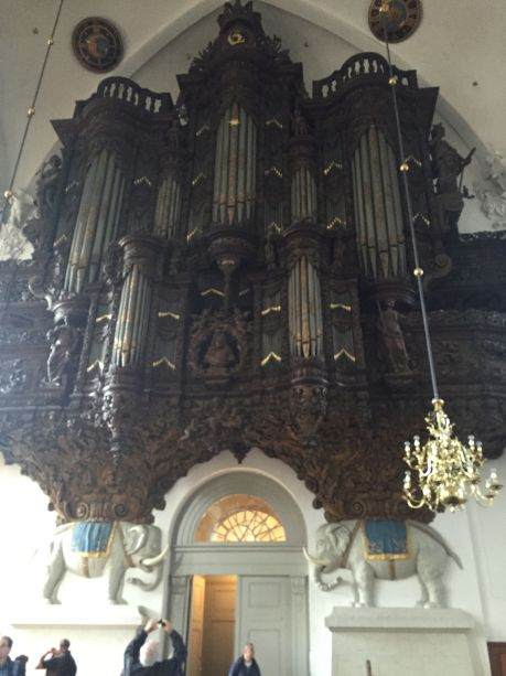 carved wooden pipe organ in church across from Christiana. photo by Karen