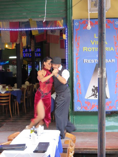 Argentine Tango dancers draw your attention in La Boca, where the dance originated