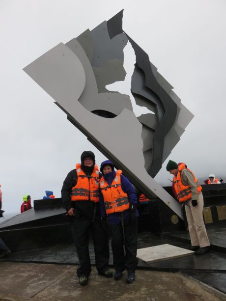 Russ, me & 3 layers of thermal with Albatross Monument on Cape Horn. photo by Susan Cramer