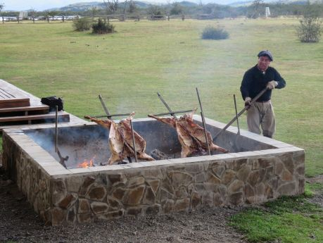 Barbequing lamb outside Hotel Rio Serrano. photo by Russ Wagner