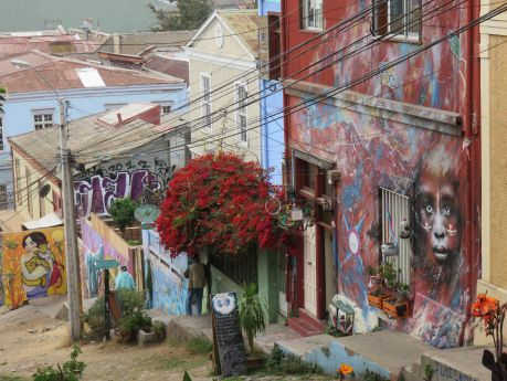 One of many steep narrow streets decorated in art in Valparaiso. photo by Russ Wagner