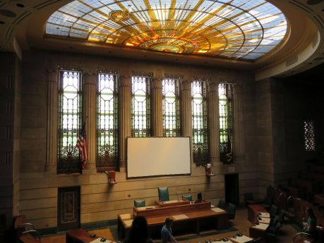 Stained glass windows illuminate the proceedings in Buffalo City Hall's Council Chambers