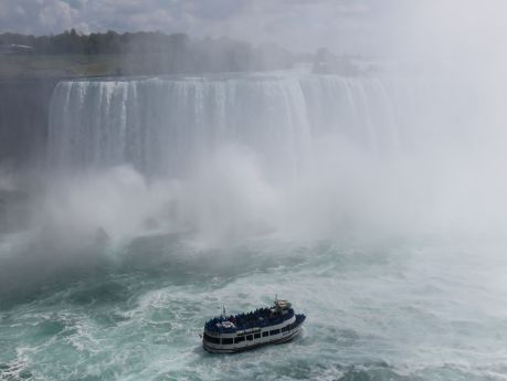 Maid of the Mist cruise boat confronts the Canadian side of Niagara Falls