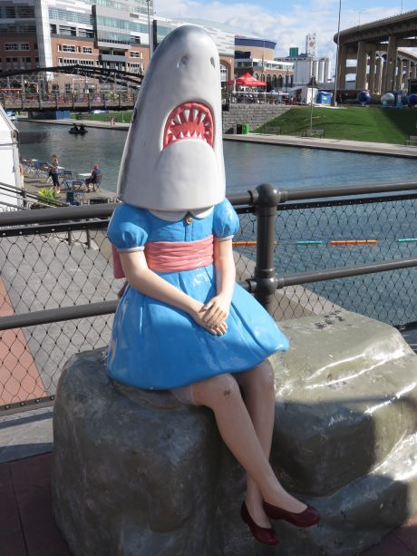 You have to wait your turn in line to grab a photo with Shark Girl